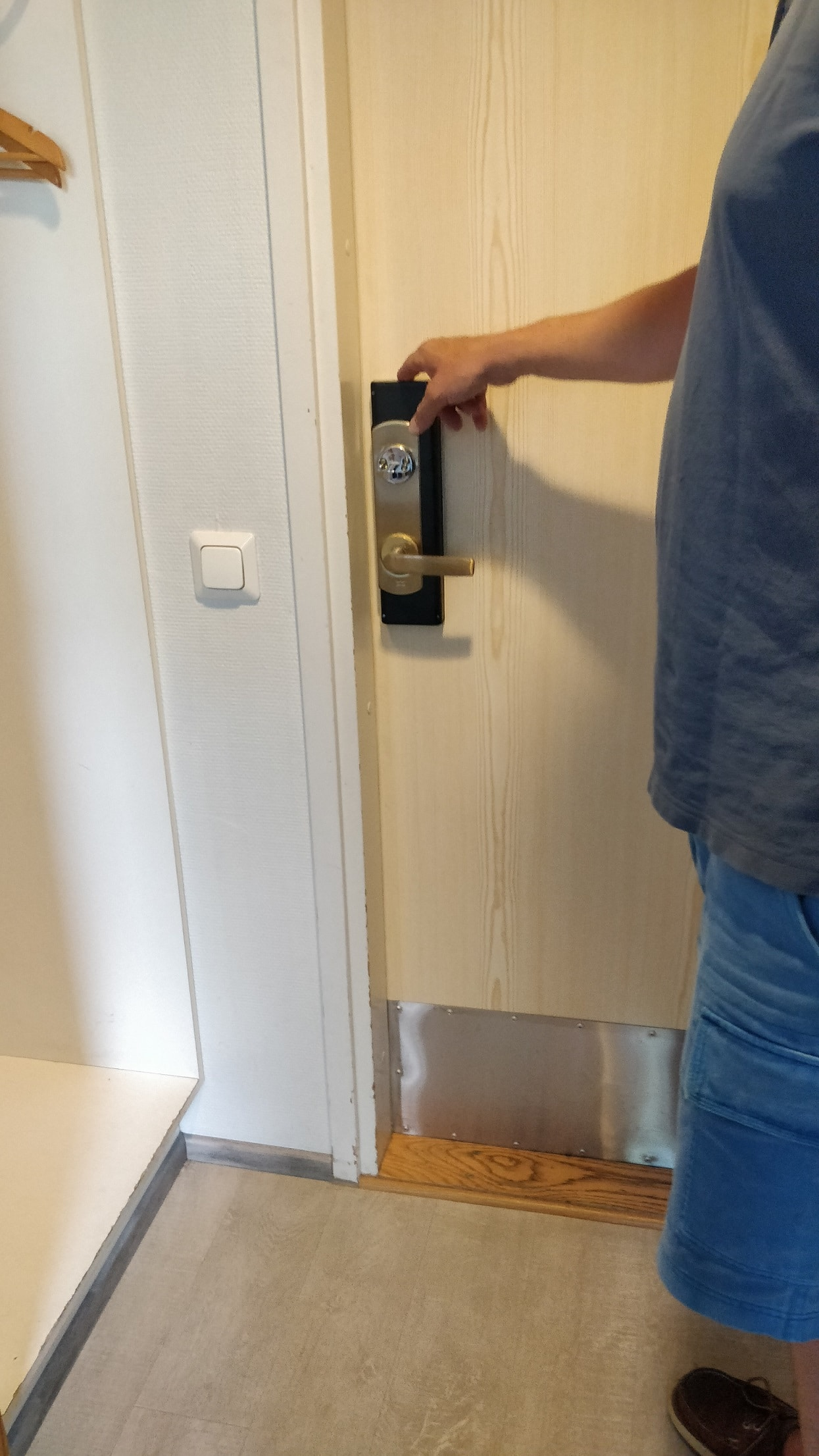 person opening hotel door from the inside